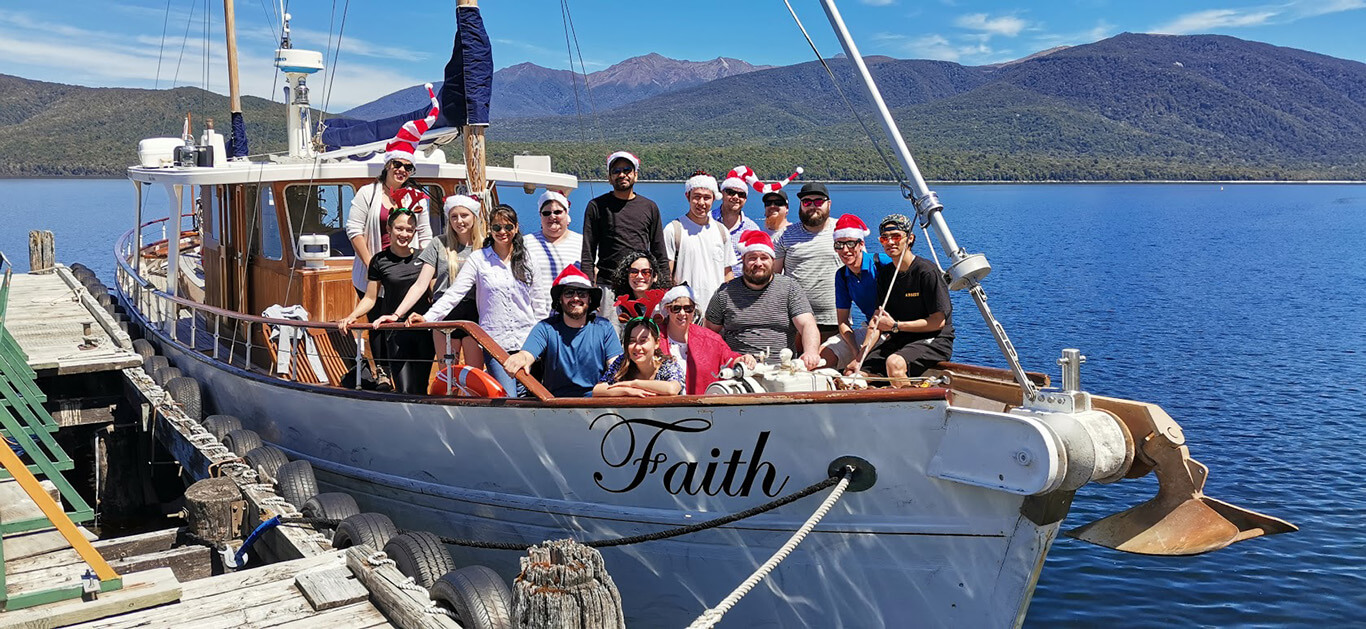 The Fat Duck Te Anau staff members gathered together for a Christmas photo onboard 'The Faith' motor-sailer.