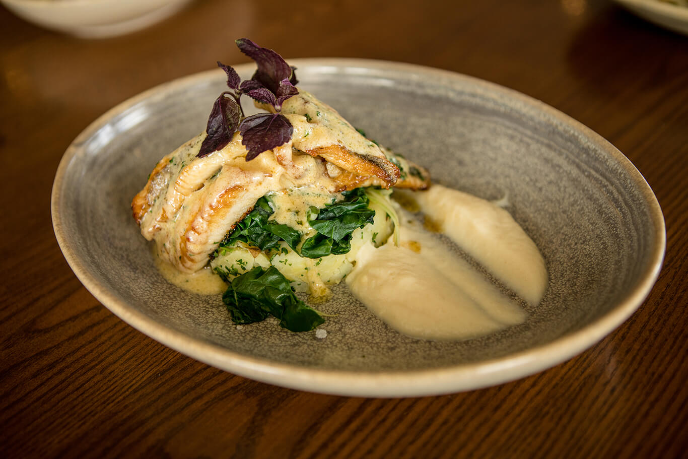 The Fat Duck's Fish of the Day, a plate of fried fish with a spinach stuffing and a white sauce.